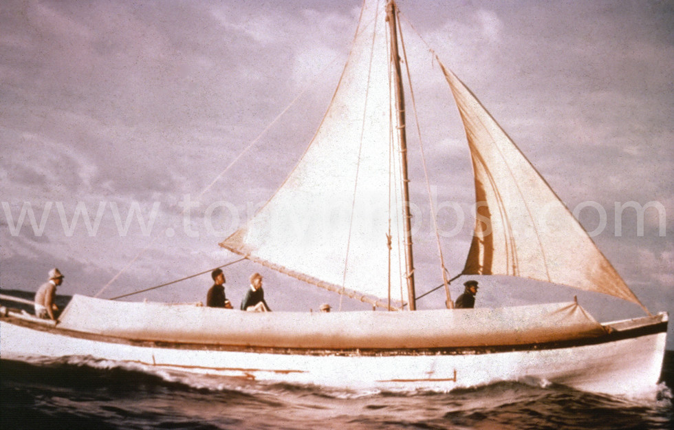 1974 Sailing to Oeno Skipper Wilkes Pervis Andre on bow