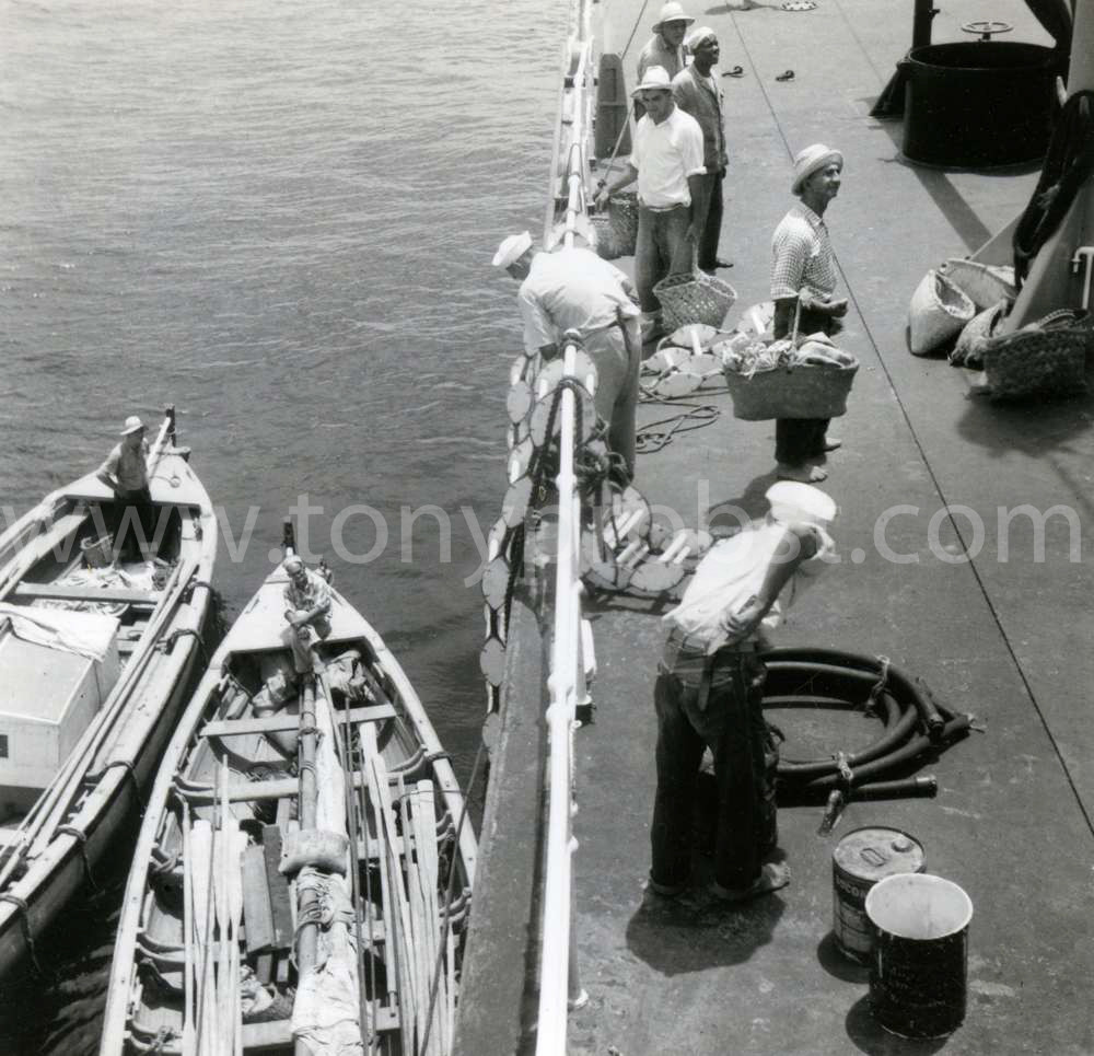 1944 Andrew, Oliver in boats. seven oars on each side. Virgil Christian with basket. Clinton Warren, Alan Christian