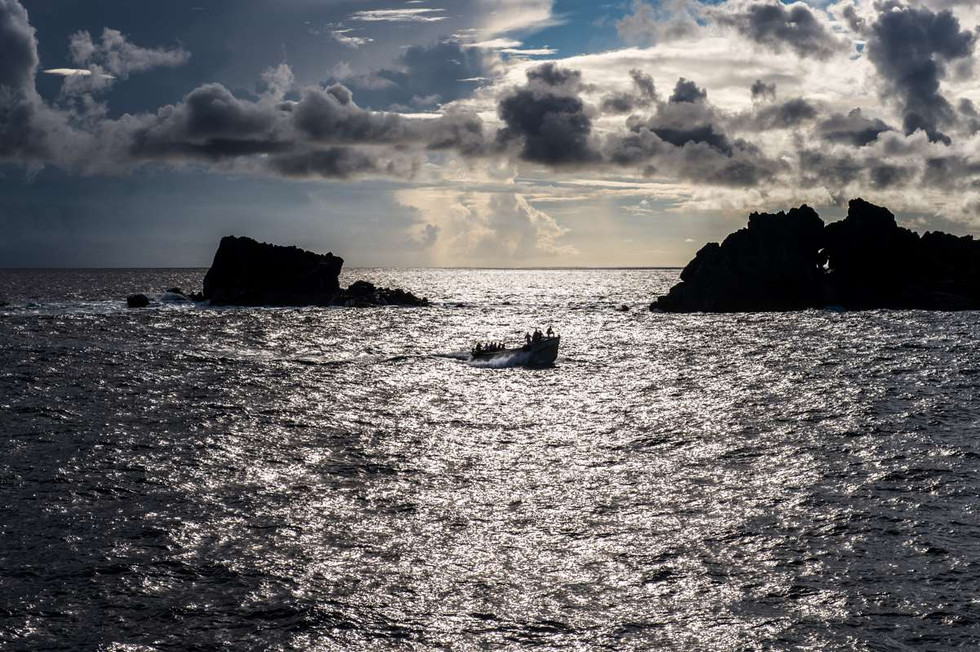 The Pitcairn islanders coming out in the early morning to take us ashore
