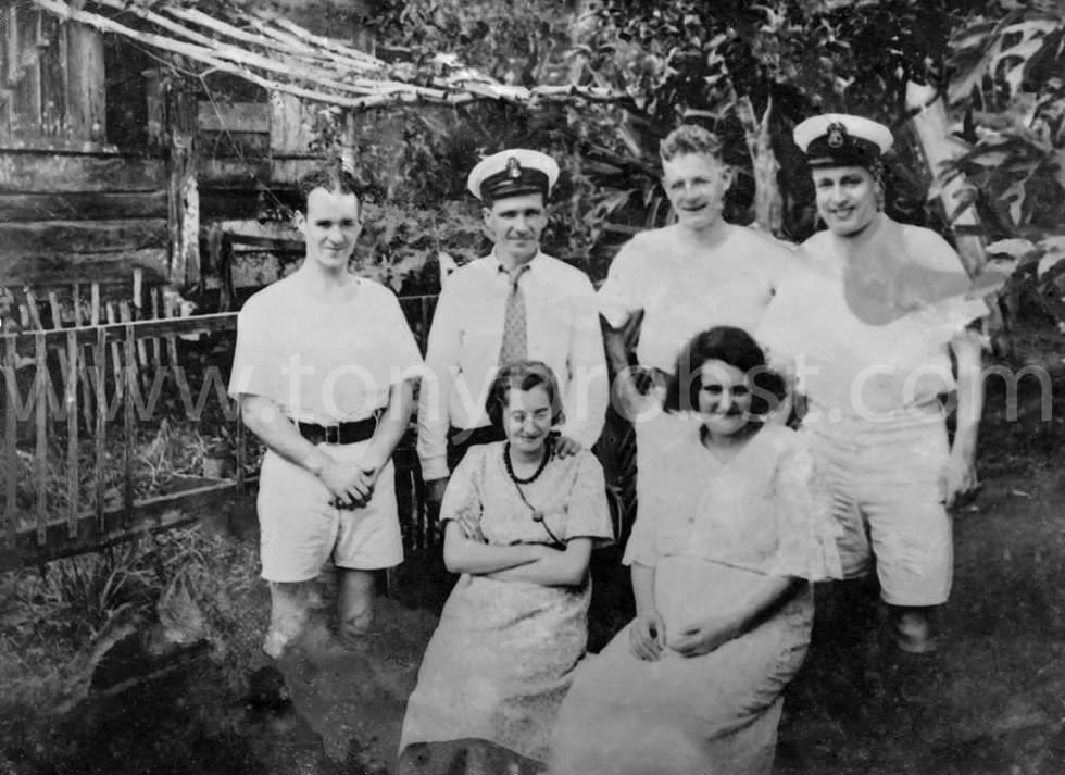 1937 Officers from  H.M.S. Leander 2nd left Roy Clark Seated Elvina Clark May Clark. In front of Thursday October's house