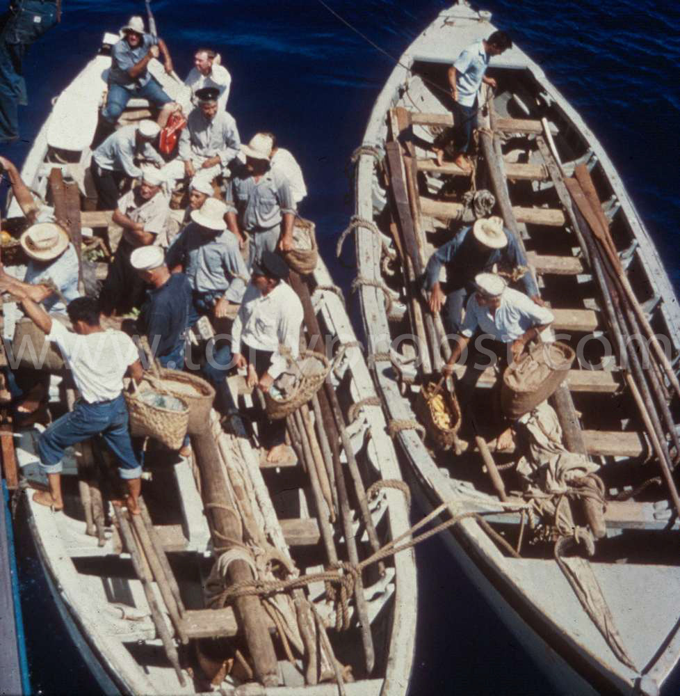1958 Two Longboats along side a ship