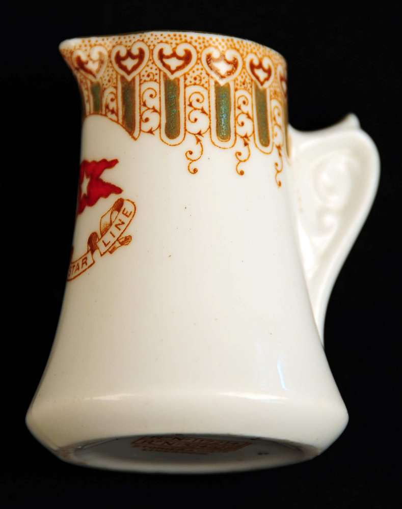 Small turquoise pattern first class milk creamer