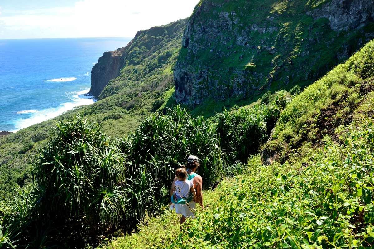 Adrianna Christian & Brenda Christian walking down the hill to the shore atTautama