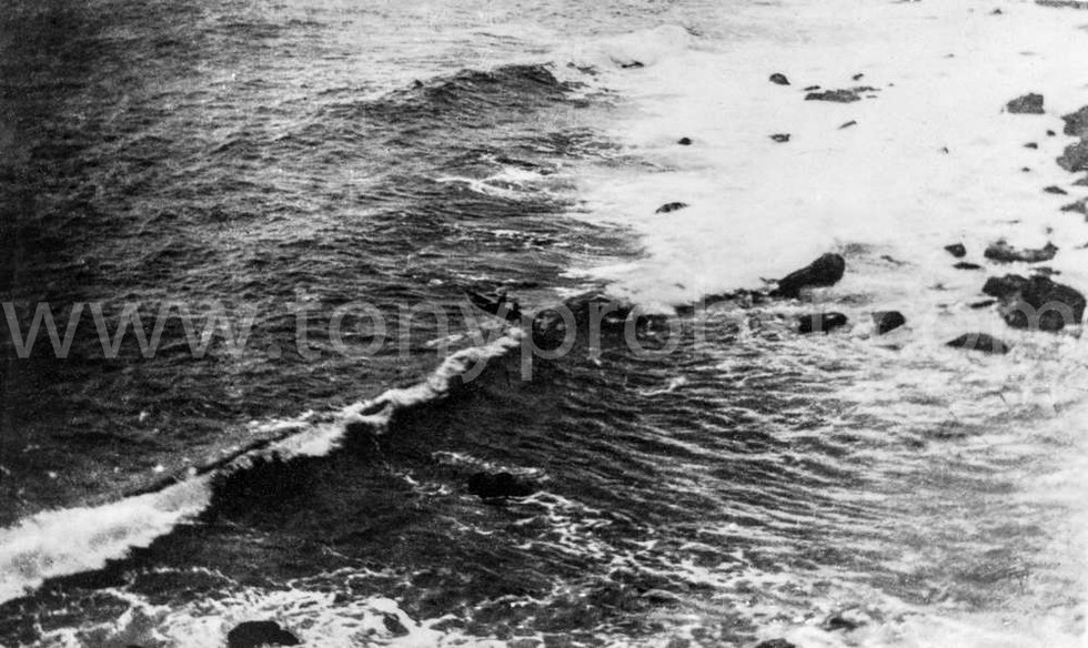 1933 Fishing boat going out through the surf at Bounty Bay