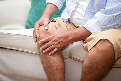 an-elderly-man-with-a-knee-pain-sitting-