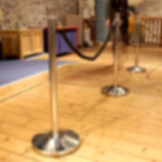 barriers and ropes set up on a floor