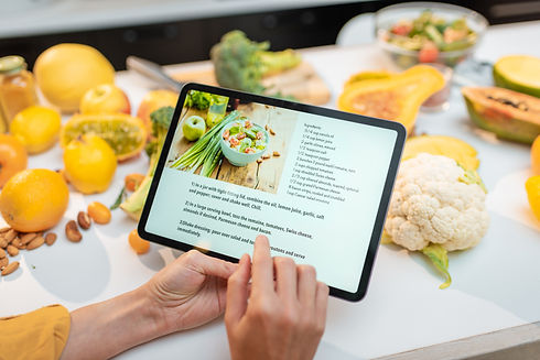 cooking-food-using-recipe-on-a-digital-t