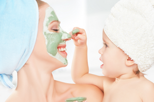 Mom and baby putting on face mask