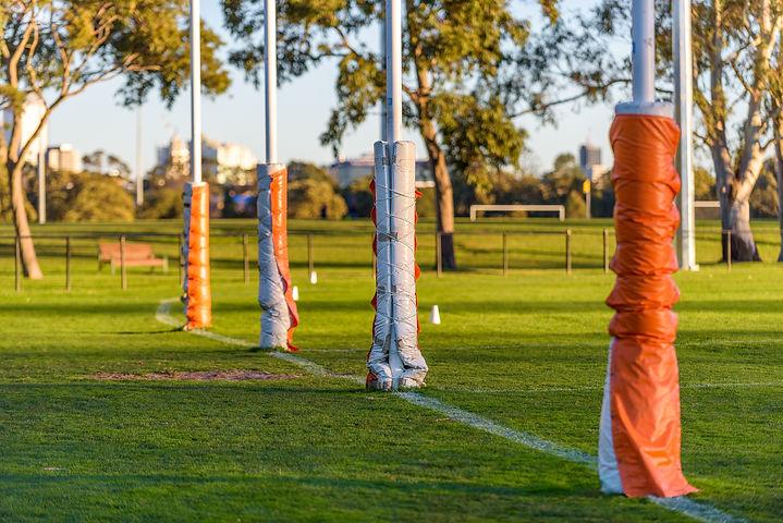 Four Australian football goal posts wrap