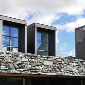 Fabricated steel dormer window surrounds and custom chimney shrouds