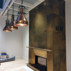Antiqued brass fireplace cladding