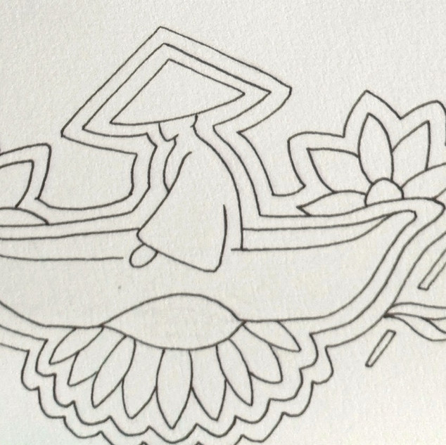 Man in rowing boat + flowers and bamboo