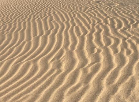 Weg met het zand! De belaste plek van de leidinggevende.