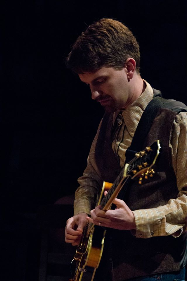 Brian playing guitar