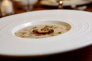 Quail Meat Congee with Wild Mushrooms an