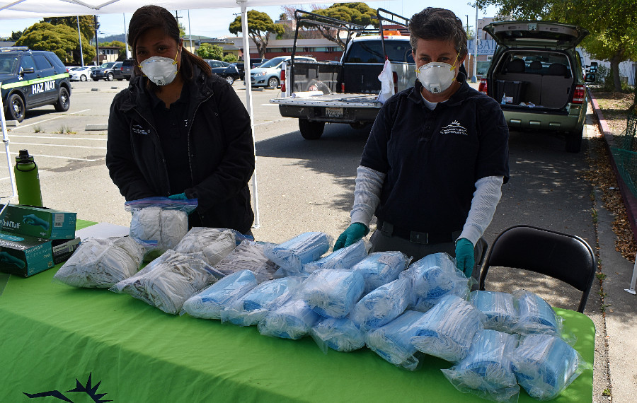 Hazardous Materials staff work at a personal protective equipment donation center