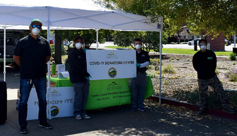 Volunteers collect donations of personal protective equipment for healthcare workers