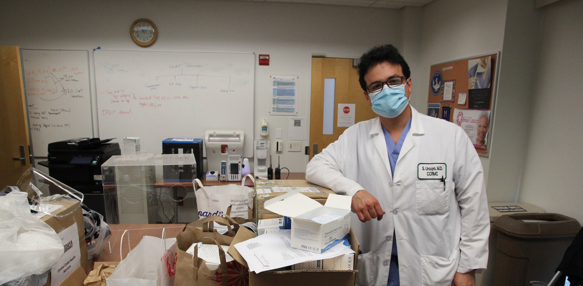 Dr. Sergio Urcuyo organizes personal protective equipment generously donated by the community for use by healthcare workers