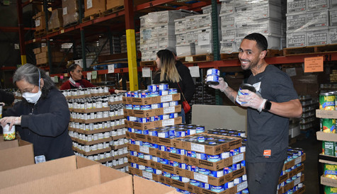 Volunteers prepare boxes of food at the Food Bank of Contra Costa