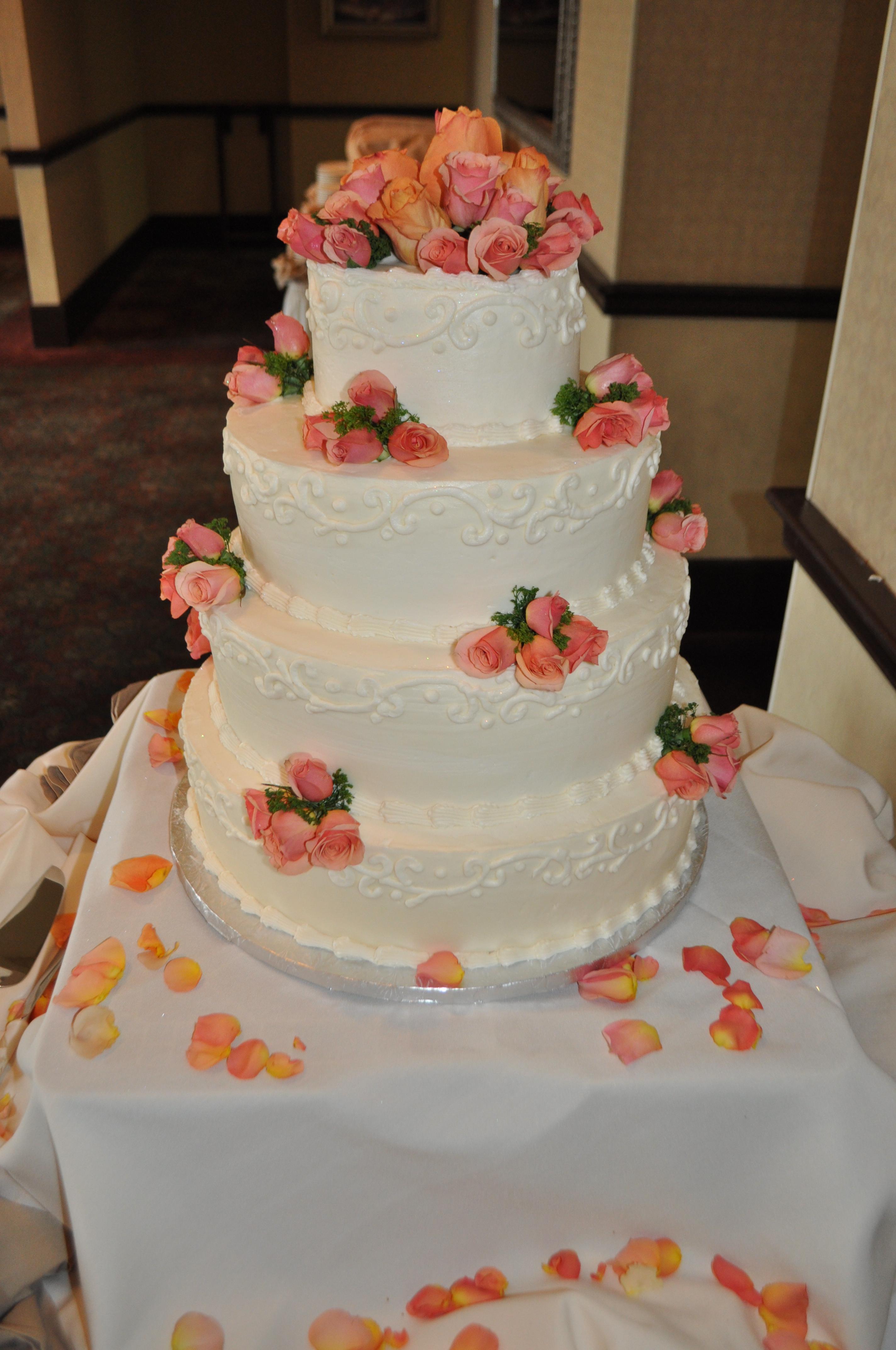 Wedding cake orange roses