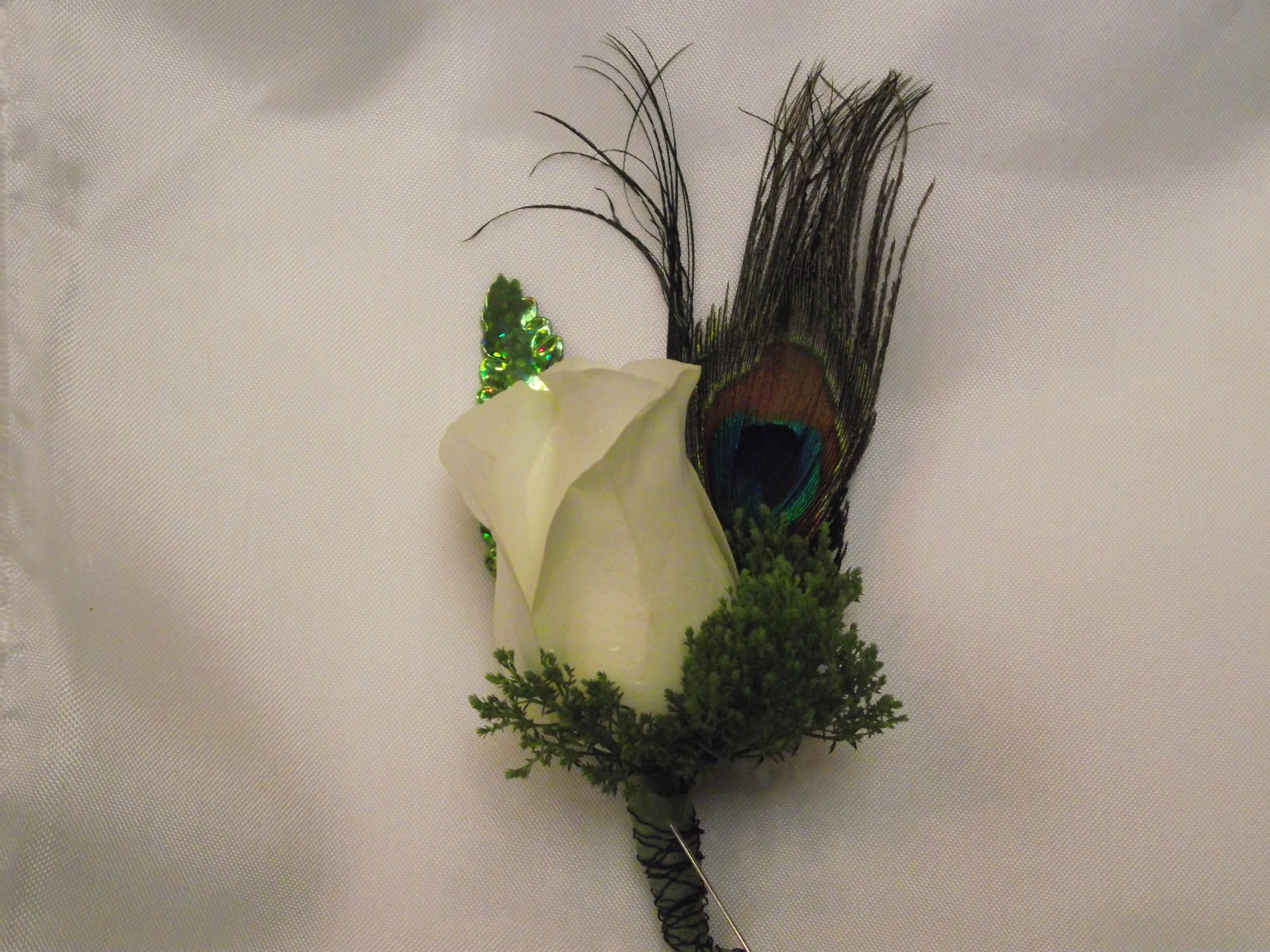 Rose and feather boutonniere