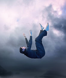 Man falling through the sky
