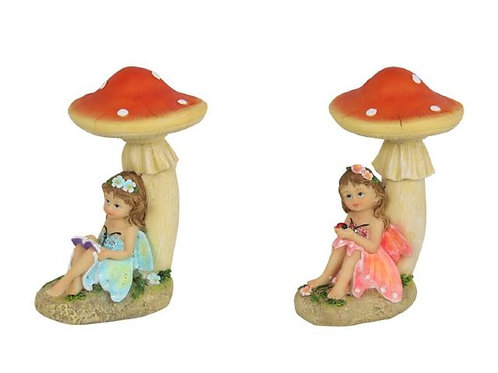 15cm fairy sitting under toadstool