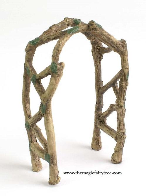 Fiddlehead woodland twig arch