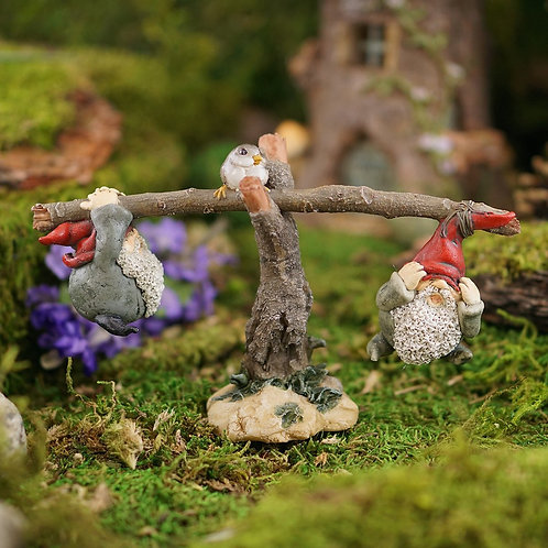 Gnomes playing on a seesaw