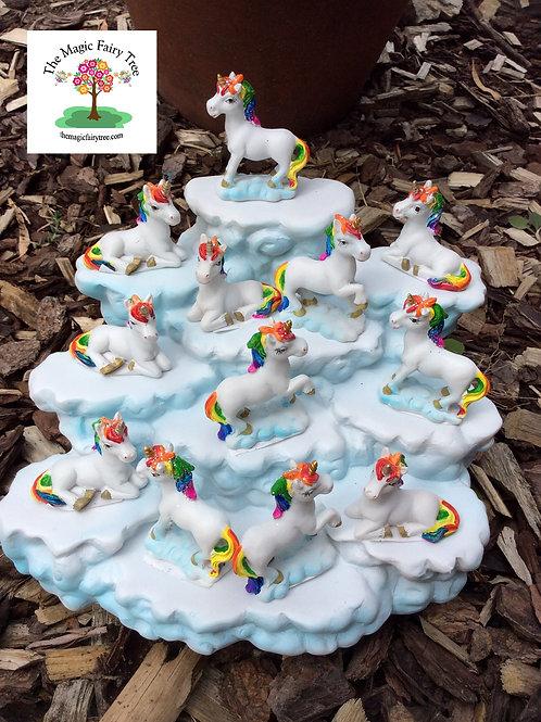 Rainbow unicorn figurines on display stand