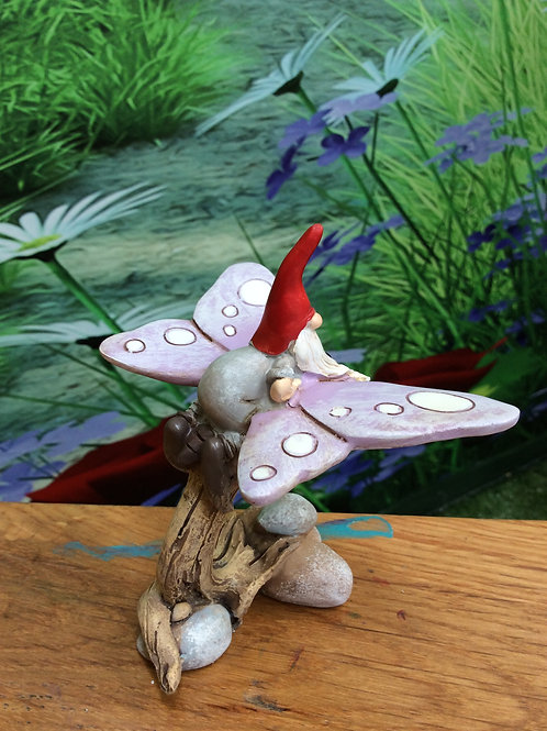 Gnome riding a butterfly figurine