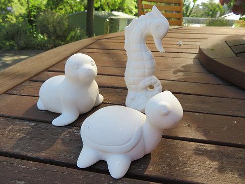 Ceramic sea turtle, seal and seahorse figurine
