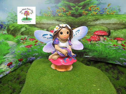 Mini World miniature fairy sitting on a toadstool
