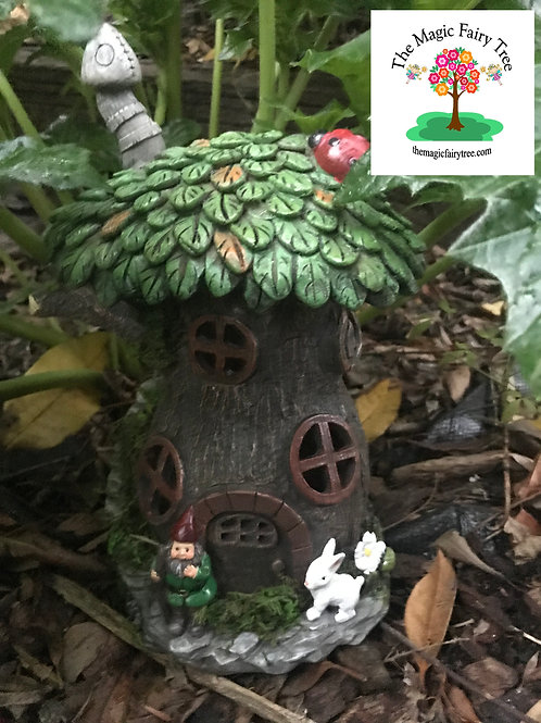 Solar gnome treehouse with rabbit figurine