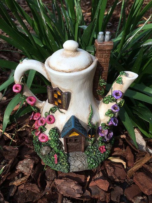 Solar powered teapot fairy house