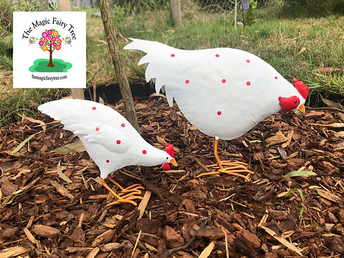 Set of 2 white metal feeding chickens