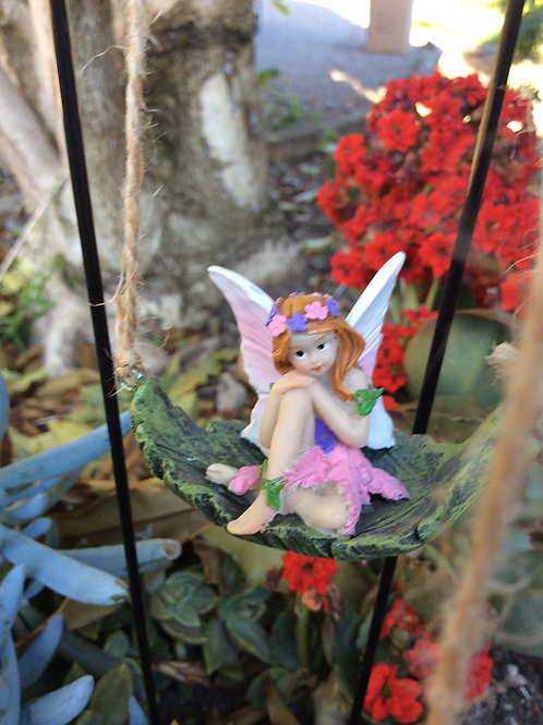 Swing fairy.  Fairy sitting on a leaf swing with metal stake