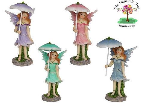 11cm fairy standing under umbrella