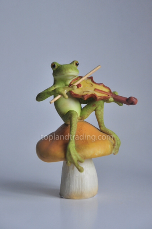 Frog playing fiddle on a toadstool