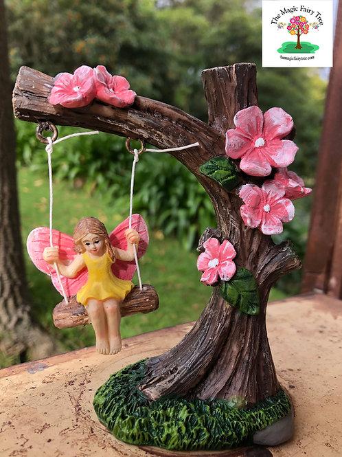 Garden fairy on swing