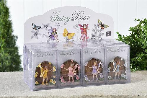 Miniature fairy door with fairy figurine