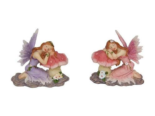 Fairy kneeling on mushroom