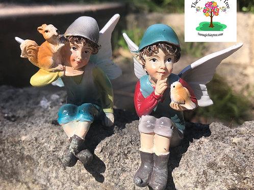 Sitting Elf Figurine with Squirrel or Bird