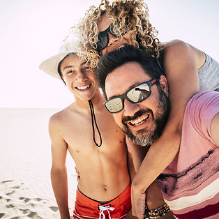 happy-family-outdoor-at-the-beach-during-a-vacatio-S66B8XR_edited.jpg
