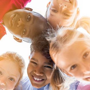 happy-children-in-circle-PBEVQ7K_edited.jpg