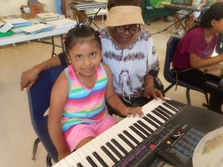 Little girl piano player.jpg