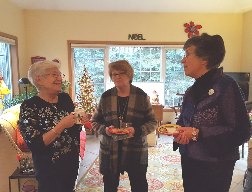 Barb Hunt, Nancy Haacke and Pat Cramer enjoy catching up at the party