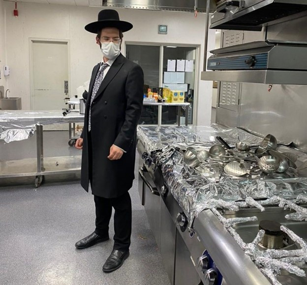 Rabbi Yissachar Krakowski, performing kosher supervision at a hotel in Abu Dhabi, UAE (Jewish Press)
