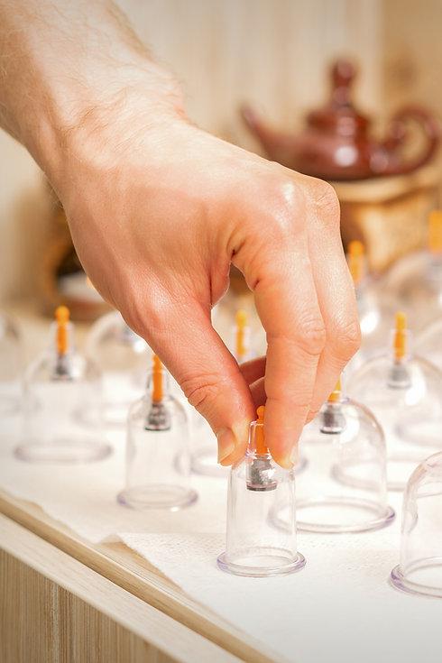 masseur-takes-vacuum-massage-glass-jars-