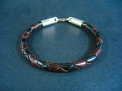 Multi-coloured bracelet with silver endings